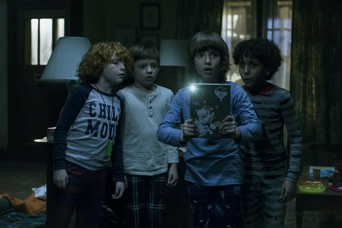 """(L to R) Gavin Maciver-Wright as """"Zach"""", Winslow Fegley as """"Byron"""", Azhy Robertson as """"Oliver"""", and Jayden Marine as """"Mateo"""" in writer/director Jacob Chase's COME PLAY. Credit : Jasper Savage / Amblin Partners / Focus Features"""