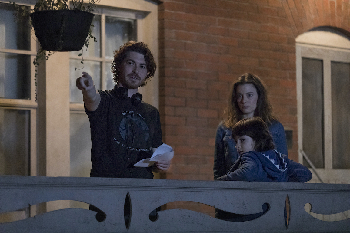 (L to R) Writer/director Jacob Chase, actor Gillian Jacobs and actor Azhy Robertson on the set of COME PLAY. Credit : Jasper Savage / Amblin Partners / Focus Features